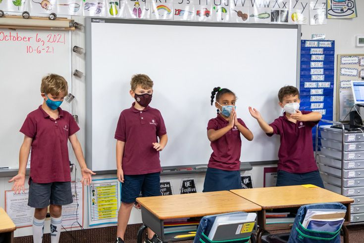 Severn School 2nd grade students demonstrating a breathe and body awareness practice.