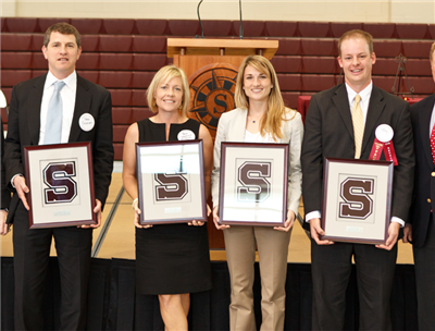 Henry A. Ciccarone '56 (accepted by his son) Anne Schorreck Wilkerson '92, Lindsey Biles Dumont '01, and John G. Neely '97