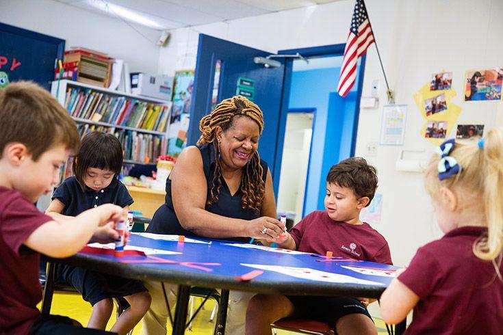 Severn School preschool students work with their teacher.