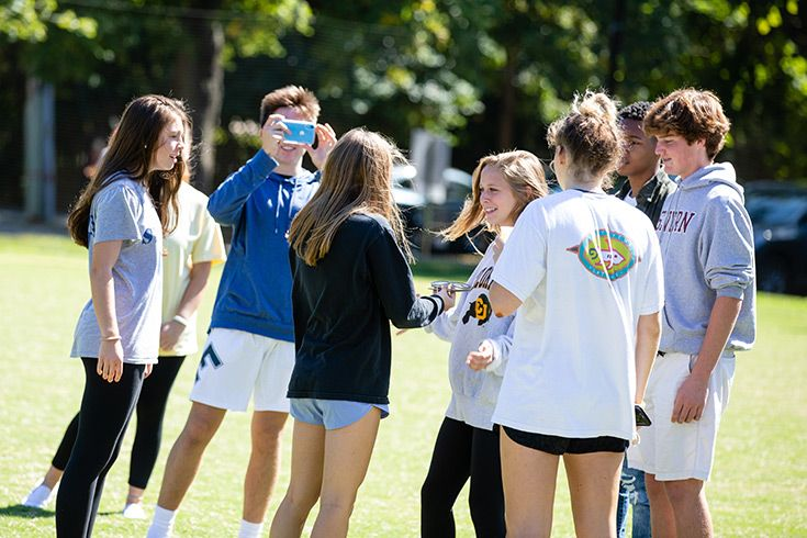 Severn School high school students shoot a video with a phone.
