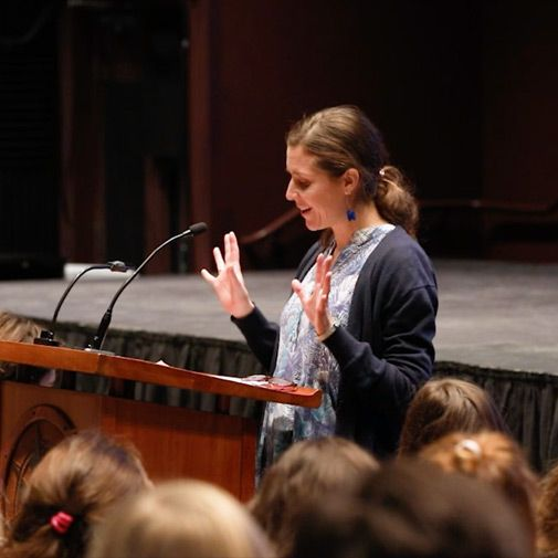 Severn School teacher speaking at a podium.