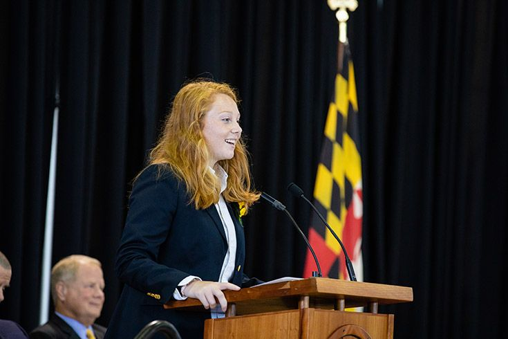 Severn School high school student gives a speech at the podium.