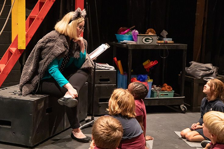 Severn School students watch a teacher demonstrate drama techniques.