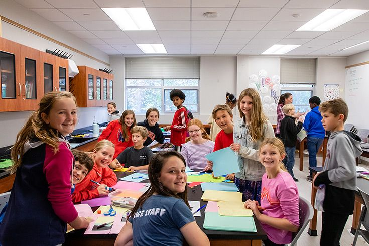 Severn School Middle School students making cards for children in the hospital.