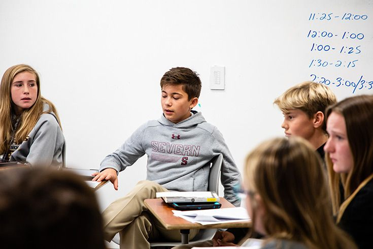 Severn School middle school students participate in a Socratic discussion.