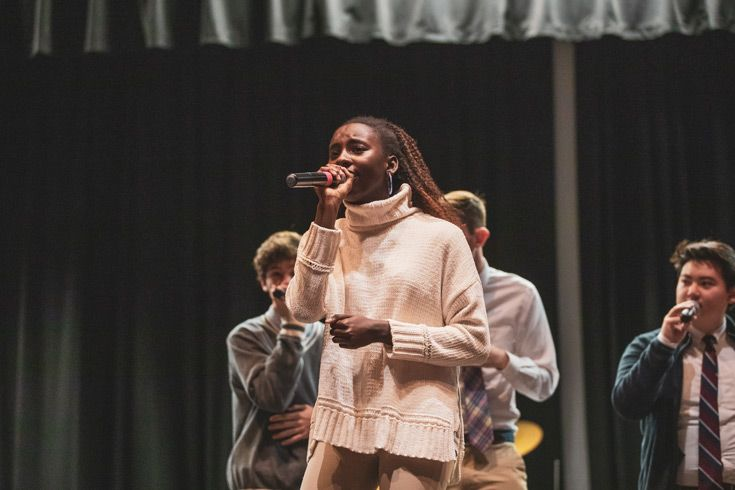 Severn School teachers high school students sing in an a capella group