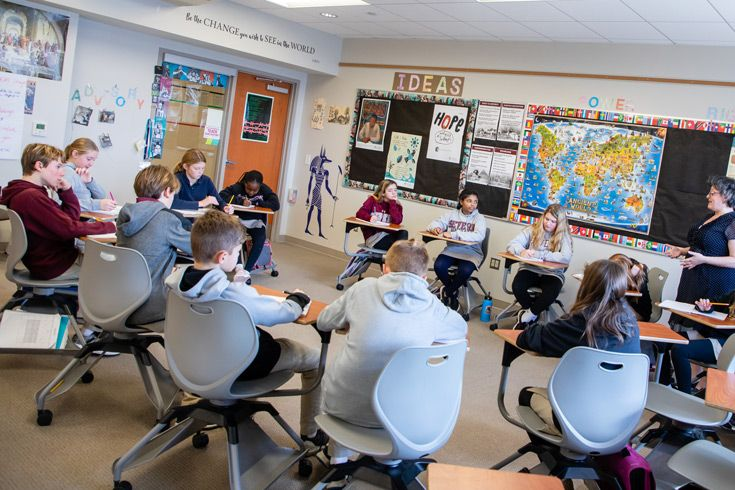 Severn School Middle School students working at their desks.