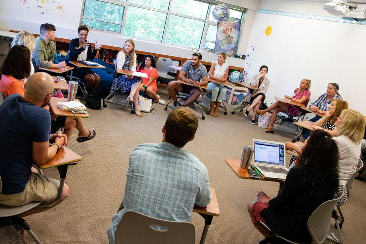Severn School teachers in a large discussion group.