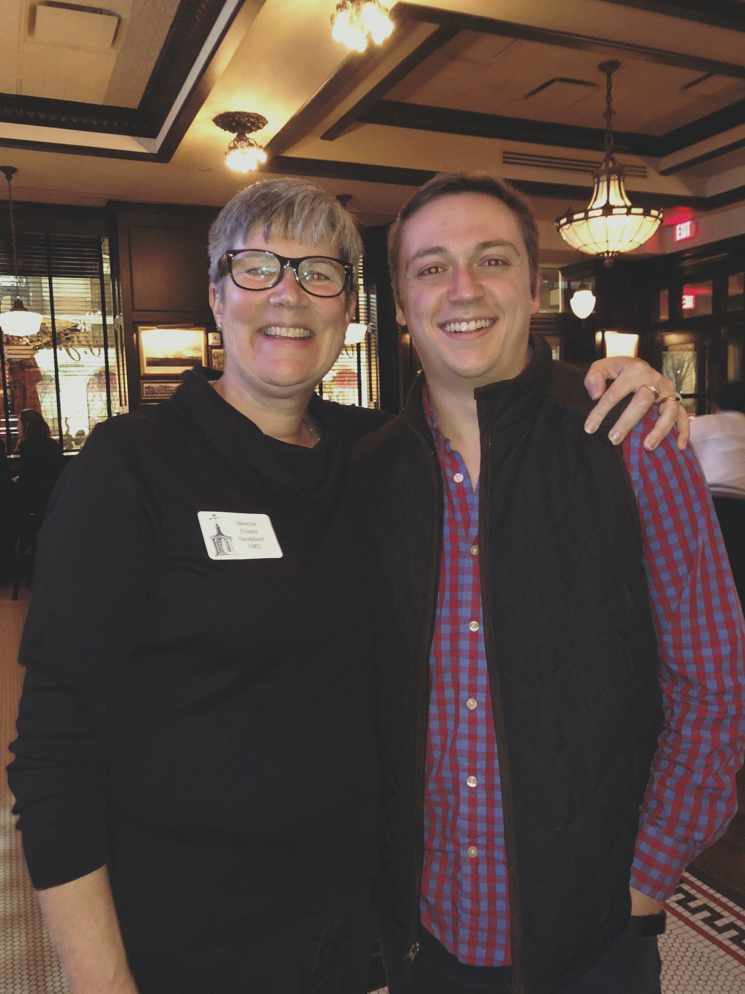 Director of Alumni Relations, Weezie Stoddard '82 shares a smile with Nick Frasco '12