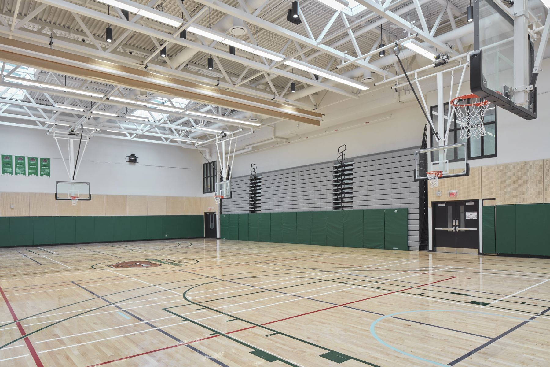 Our expanded gym, featuring retractable seating, is used for physical education classes, games, assemblies, ceremonies and more. The space is filled with natural light thanks to skylights.