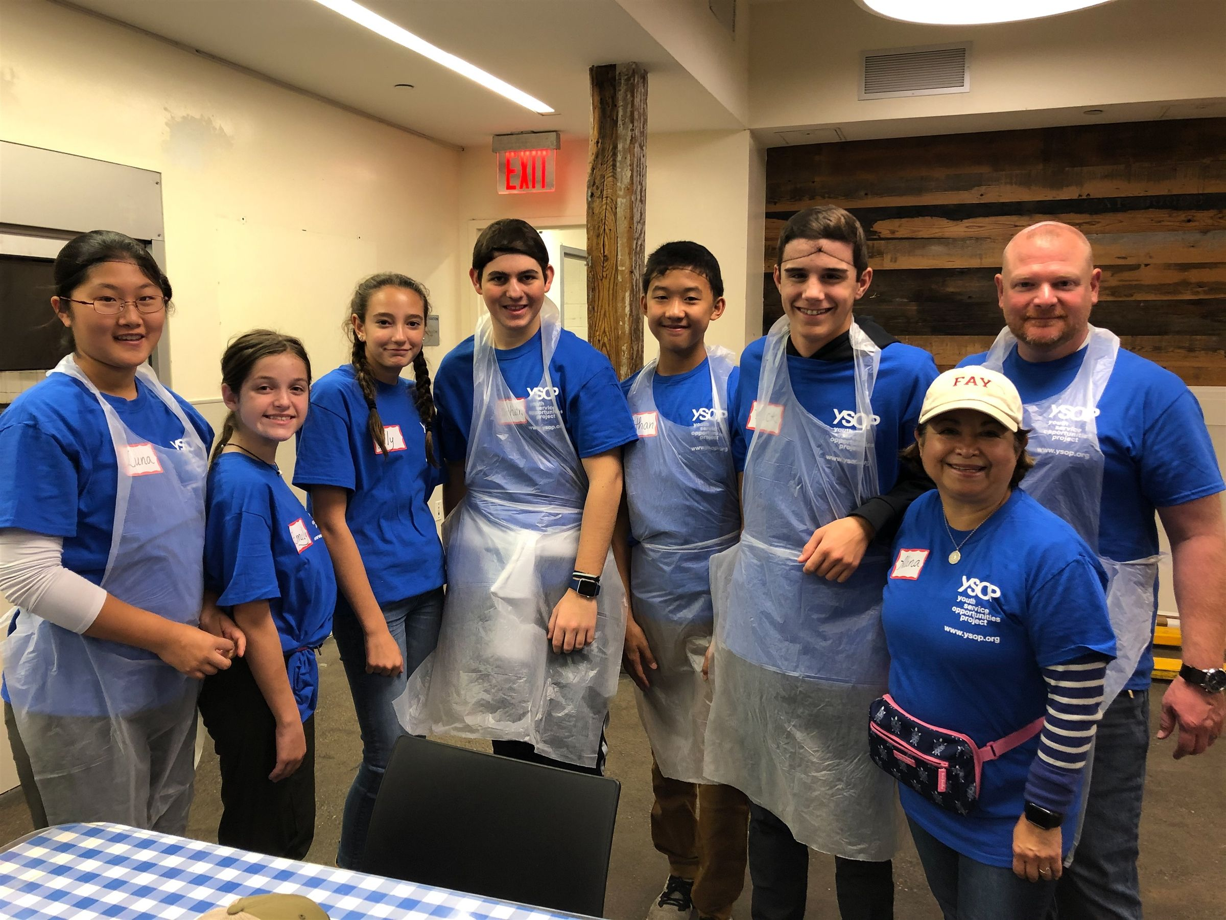 Eighth grade students in New York City working with the Youth Service Opportunities Project at a local soup kitchen.