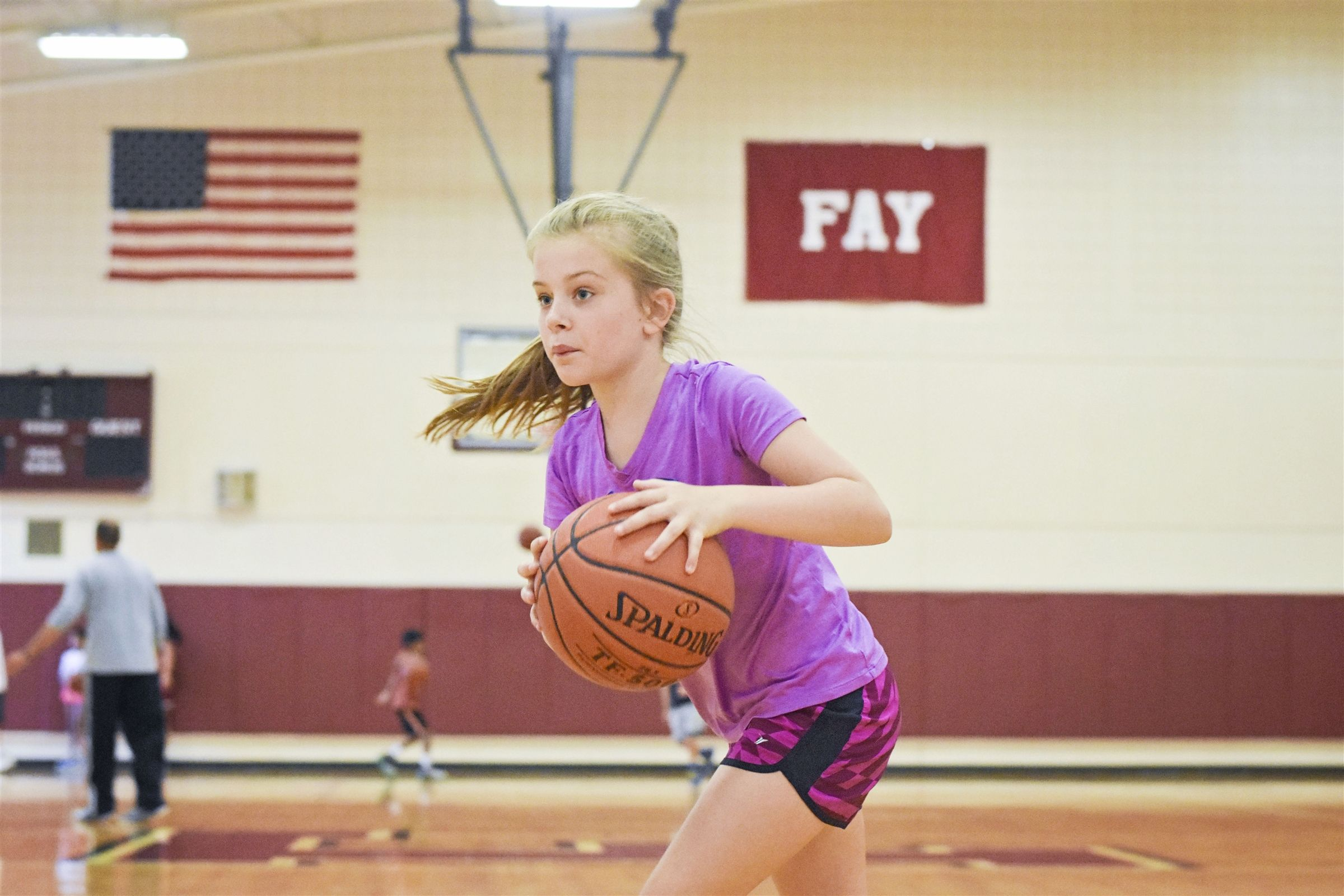Campers use Fay's Harlow Gym and its two regulation-size basketball courts to play basketball and other indoor games.