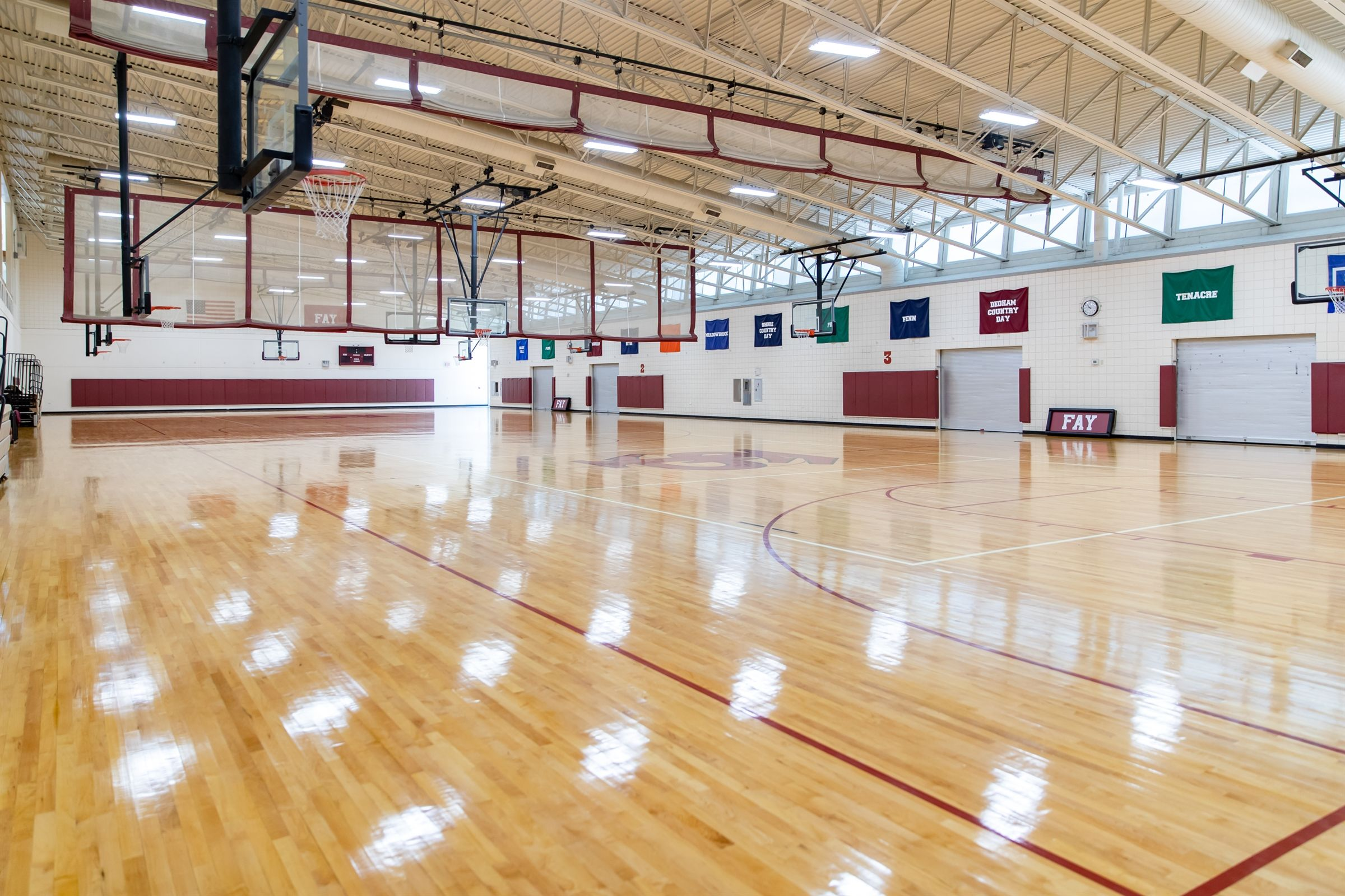 Harlow Gym is the home of our athletics program and includes two regulation-size basketball courts, rock climbing wall, wrestling room, dance studio, classroom space, and locker rooms.