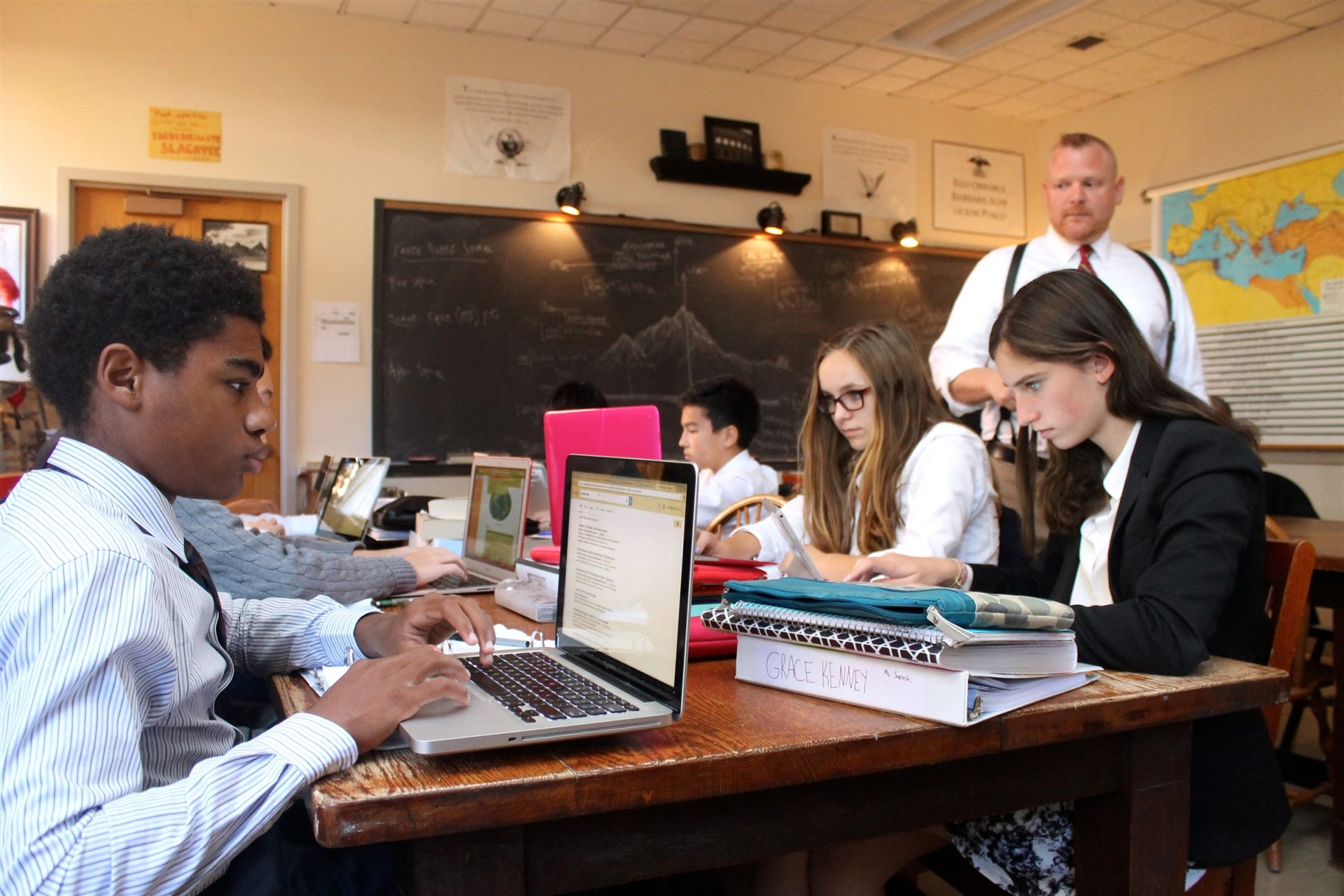 Eighth graders take Ancient History, where they explore the evolution of democracy from its origins in Greece and Rome. Through daily discussion, research, and writing, students develop an understanding of how socio-economic and political factors created change within various societies.
