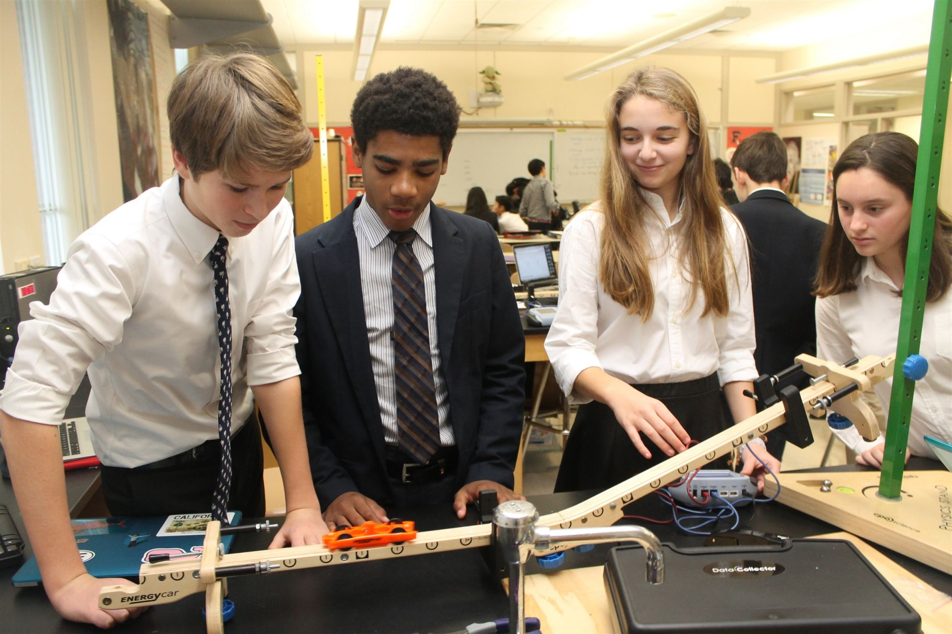 In Physical Science, eighth graders explore the properties of electricity, force and motion, and chemistry through lab-based units. Some of the highlights include a rocket simulation program in which students collect data from their own rocket launches to study the relationship between speed and acceleration. Students also love using our LEGO Mindstorm robots, where they write code to manipulate sensors and motors so the robots can perform specific tasks.