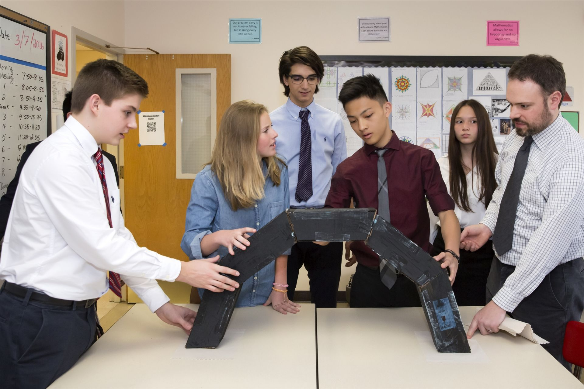 The Upper School math curriculum emphasizes the development of mathematical reasoning and the mastery of skills. Hands-on projects make abstract concepts come alive, as with this project, where geometry students applied the principles of arcs and angles to design and build a working arch.