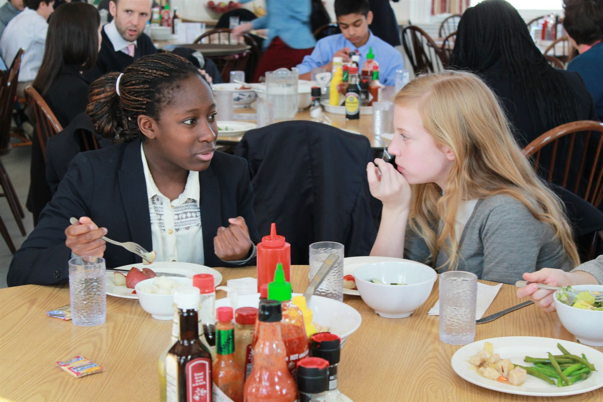 Upper Schoolers gather each day for a family-style lunch in the Dining Room. Students eat meals with classmates and teachers, and it's a great time of day to relax, reconnect with friends, and reinforce the importance of courtesy and manners. Students have assigned seating at meals, at tables that are supervised by Fay faculty and staff, as a way to encourage students to make new friends and build connections across the community.
