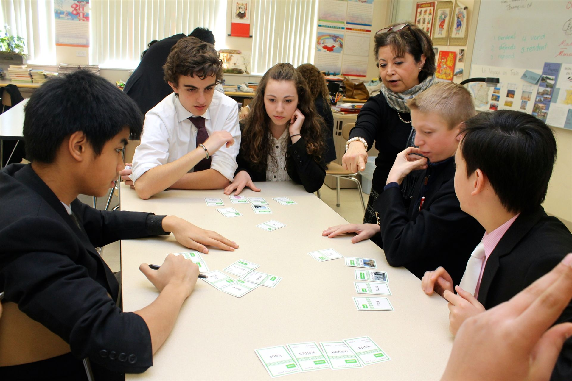 Upon entering the Upper School, students select one world language that they will study for the duration of their time at Fay. Students choose from French, Spanish, Mandarin Chinese, and Latin. All language courses provide foundational experience with writing and speaking as well as encouraging cultural awareness through music, newscasts, short films, poetry, and/or thematic projects. Even a card game can be a great way to review verb tenses!