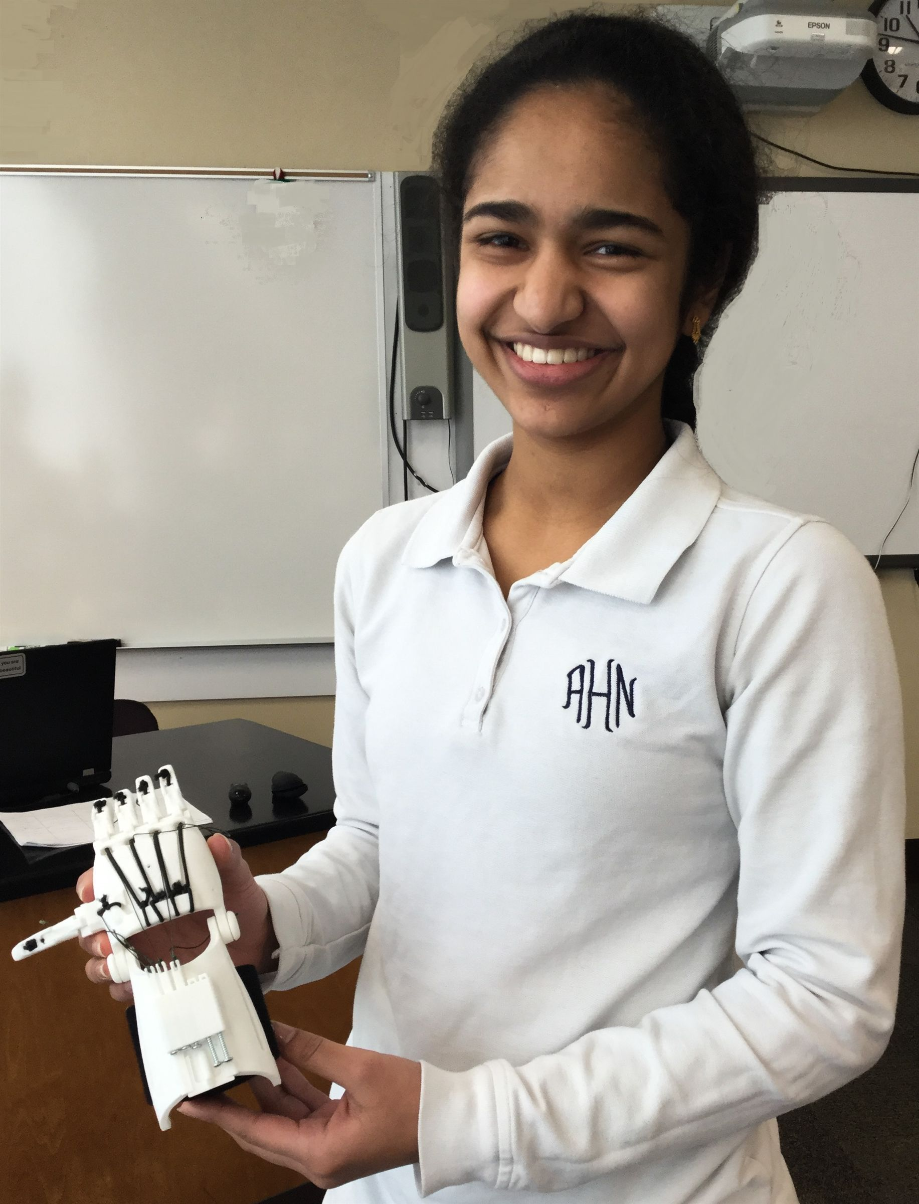 Science Research student, Andrea, displays the printed, assembled prosthetic hand that she's using to help her understand how a functioning prosthetic might be improved.
