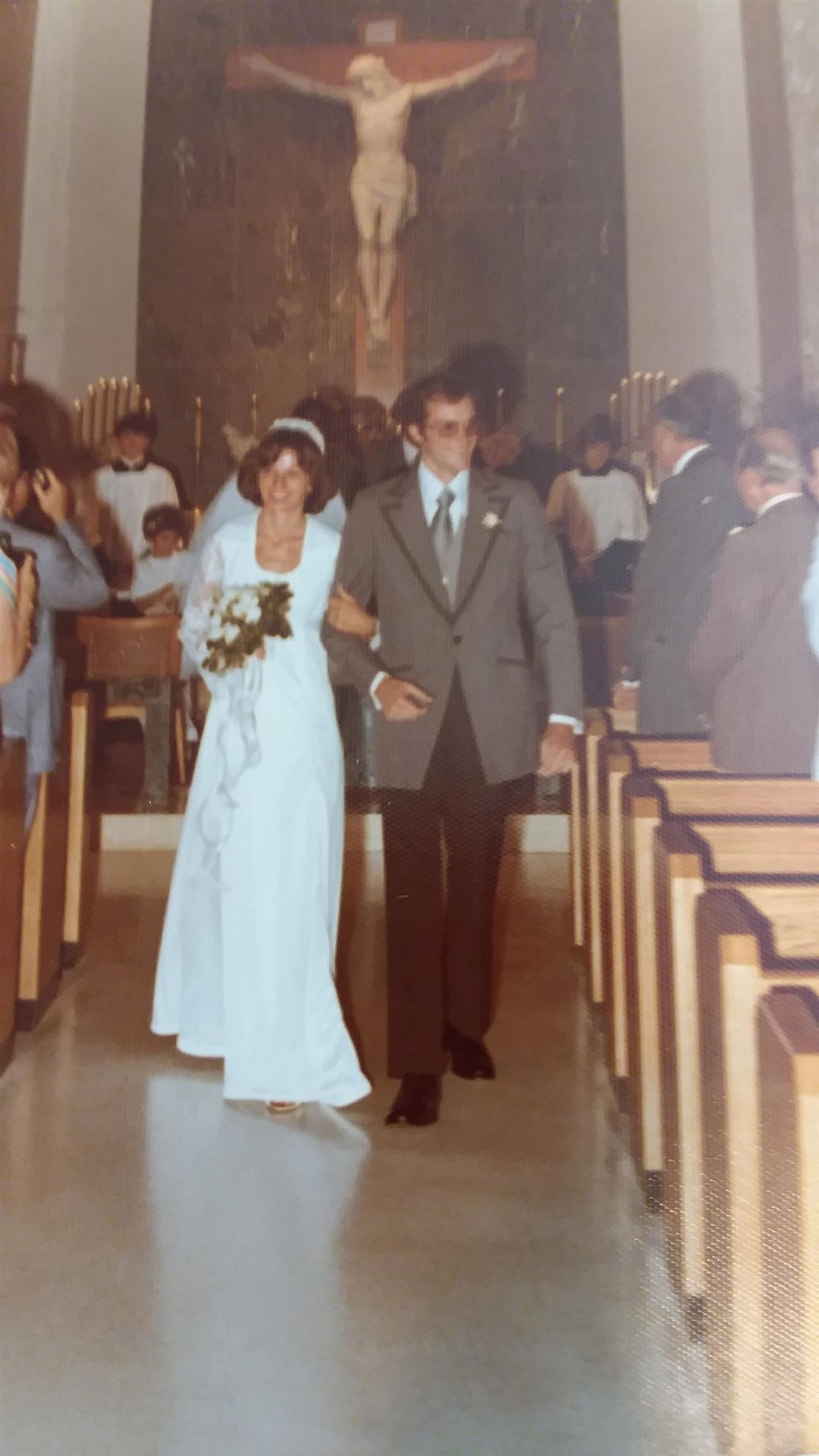 June 11, 1977: Colleen Sheehan Towle '73 and her husband of 42 years, Jerry Towle walk down the aisle.