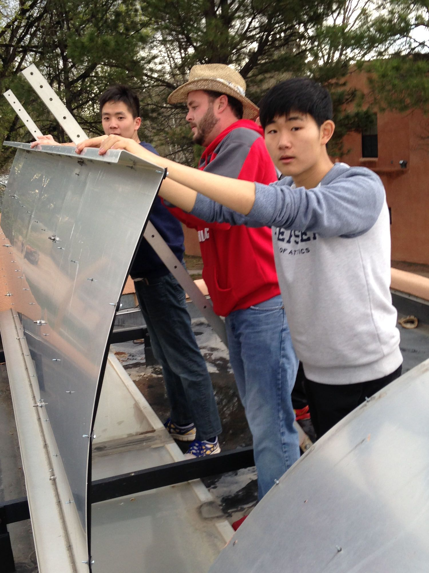 Adjusting the solar panels on Perry residence halls