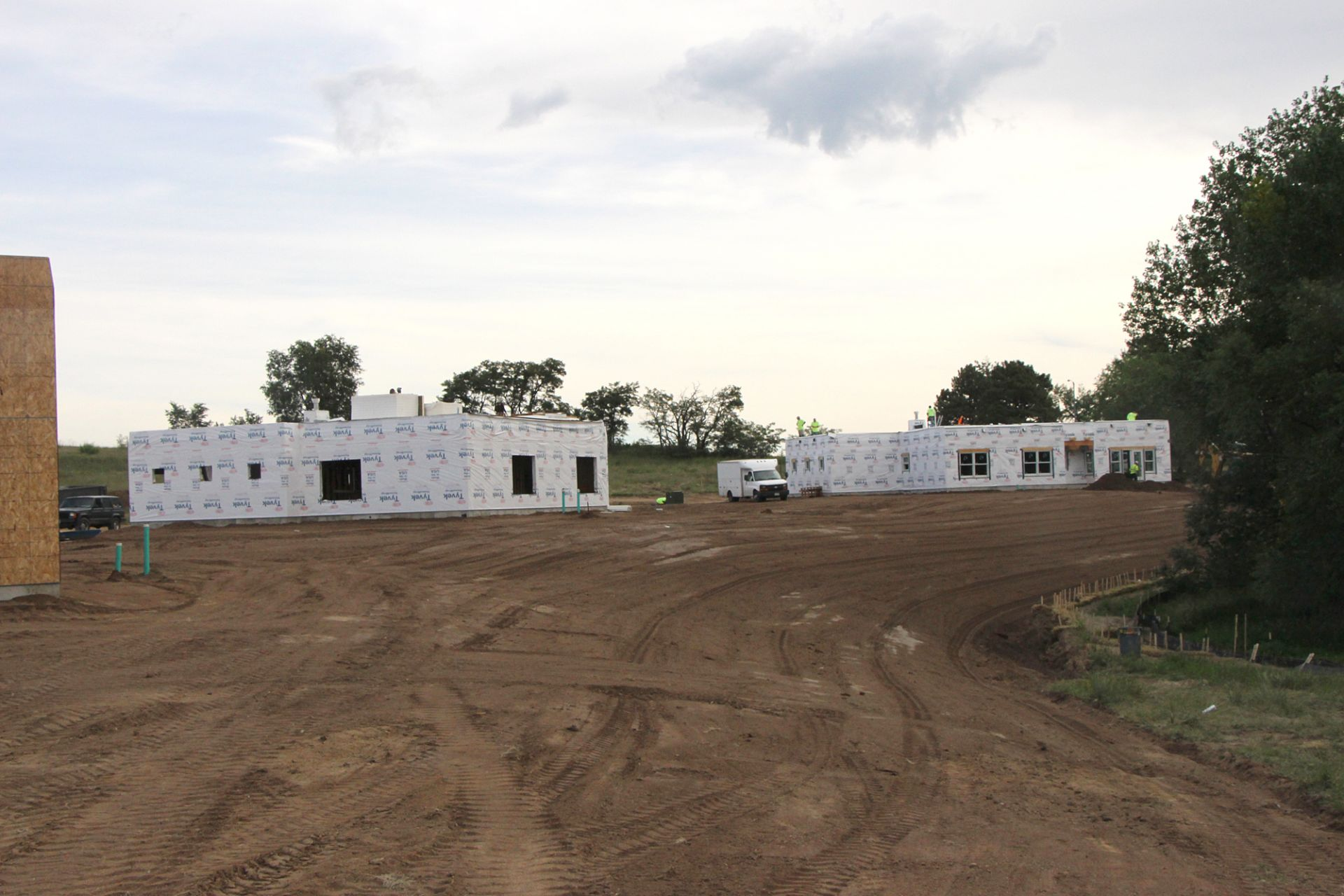 Late August photos of the new faculty housing (including a duplex) on the north side of campus, near the back gate.
