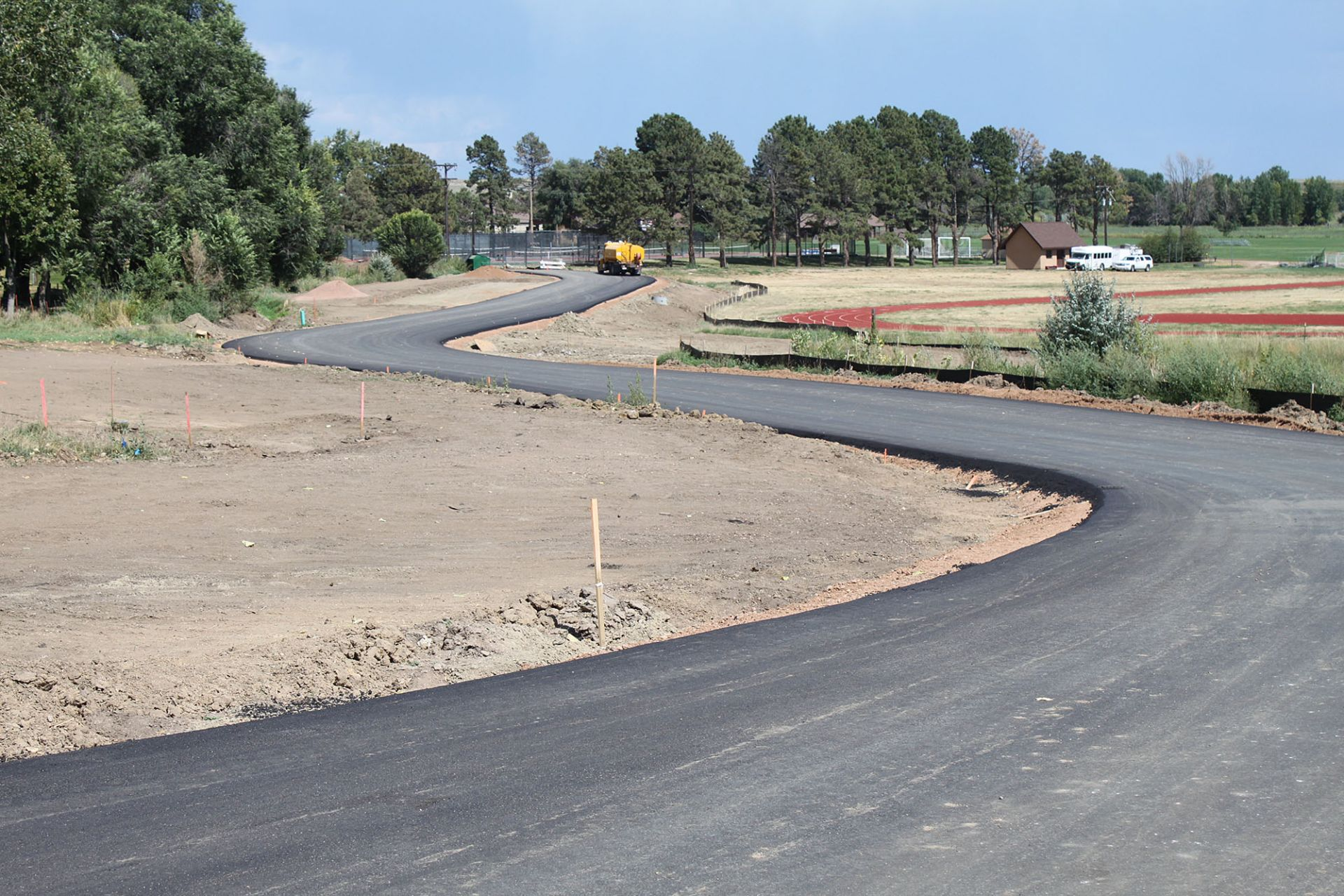 The new outer road from the roundabout behind the administration building—currently this leads to temporary athletic parking