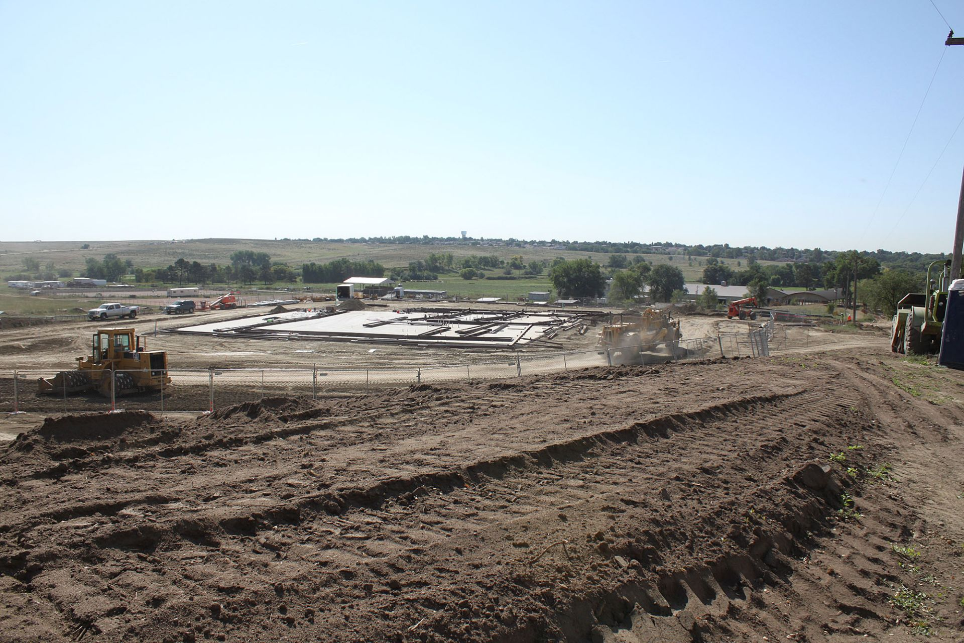 A view of the progress on the new maintenance facility located between the houses near the back gate and the paddocks