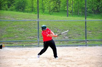 In the Elementary School Physical Education program, students learn broad range of sports like softball pictured above