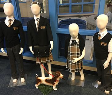 Foyer display showcases Montessori Private School uniforms