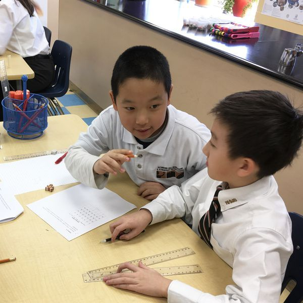 Elementary Private School students solve a complex mathematics problem during Math Olympics