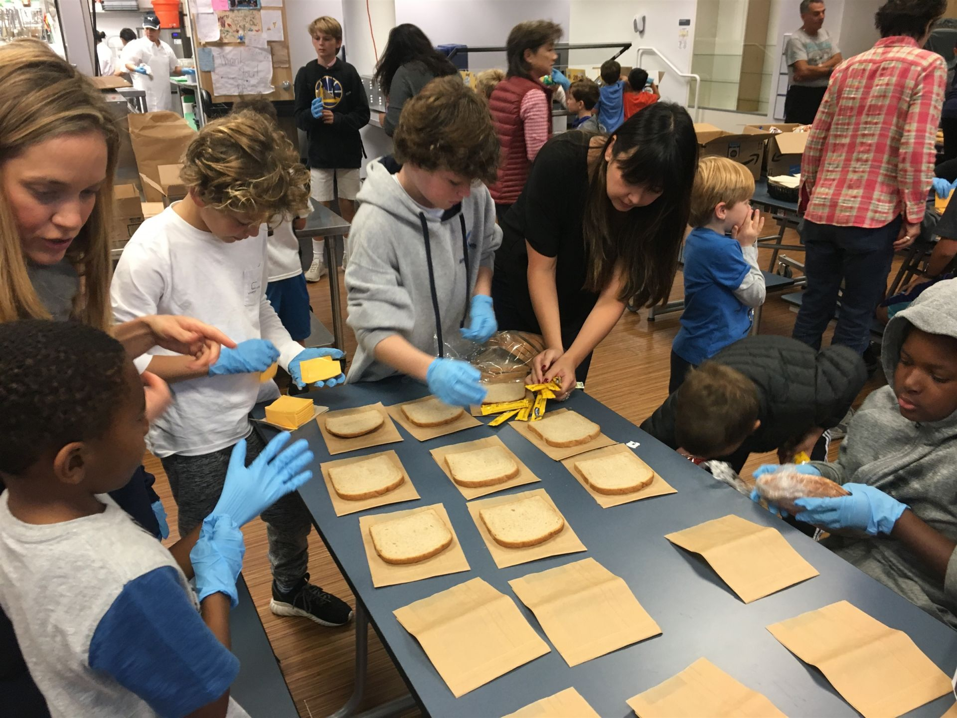 Families Making Lunches to Take to Glide Memorial