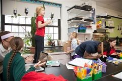 "The Primary School science room is designed to spark girls' budding curiosity about the world around them. A coral reef tank, lizards, fish, and birdfeeders help to bring nature into the classroom. Hands-on projects, such as recreating the ""food web"" that connects different sea animals, help girls to see science in action."