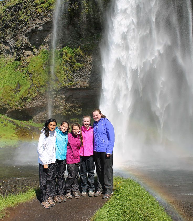 Kent Place students explore the natural beauty of Iceland at Seljalandsfoss.
