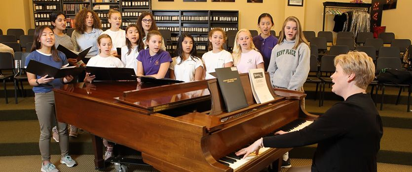 Choral classrooms contain tiered seating and baby grand pianos for practice.