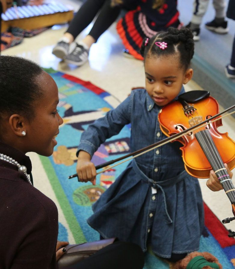 Preschool students can gain exposure to new instruments and interact with older students.
