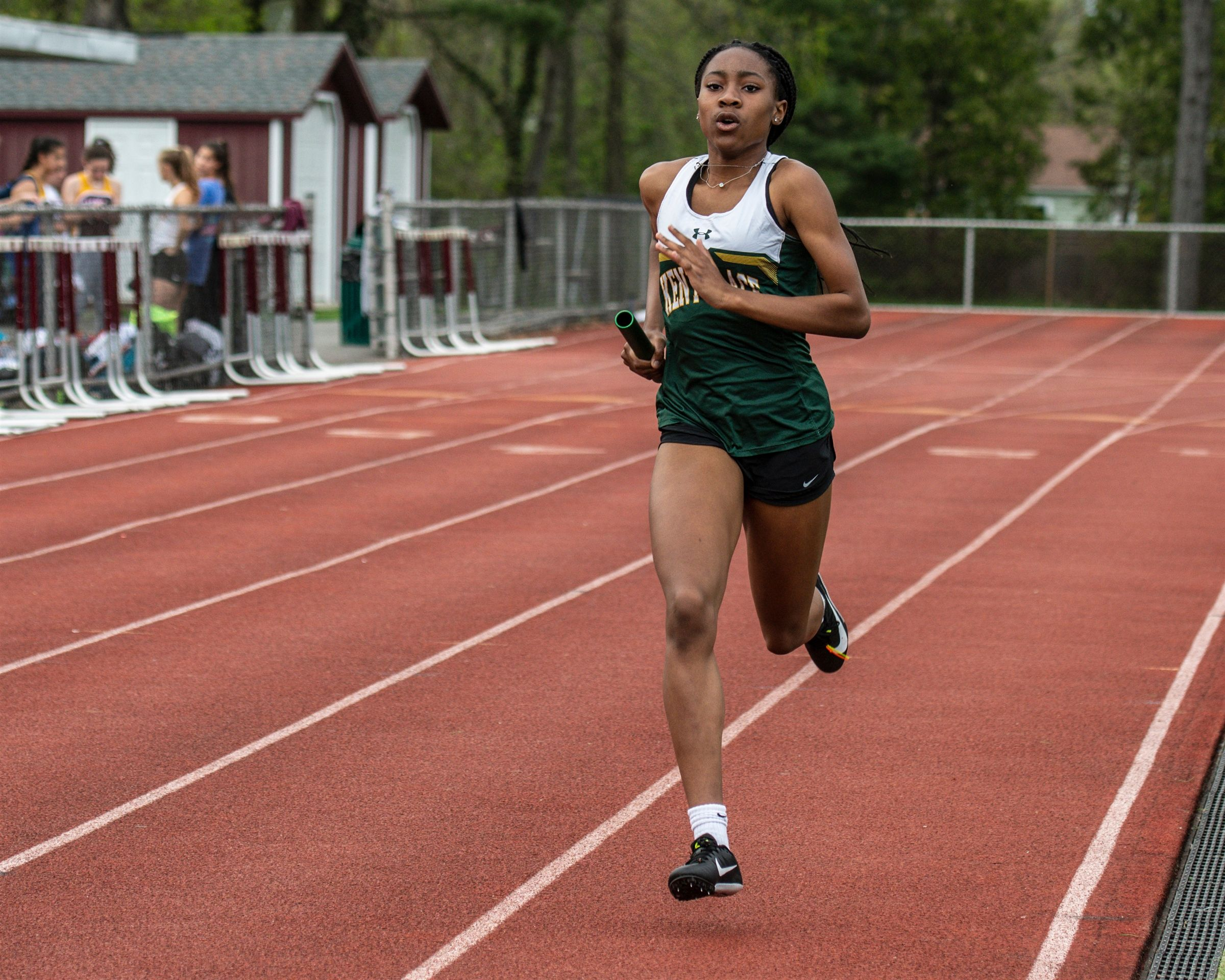 Christiana N. leads the Varsity Track 4X400m relay team to victory (2019).