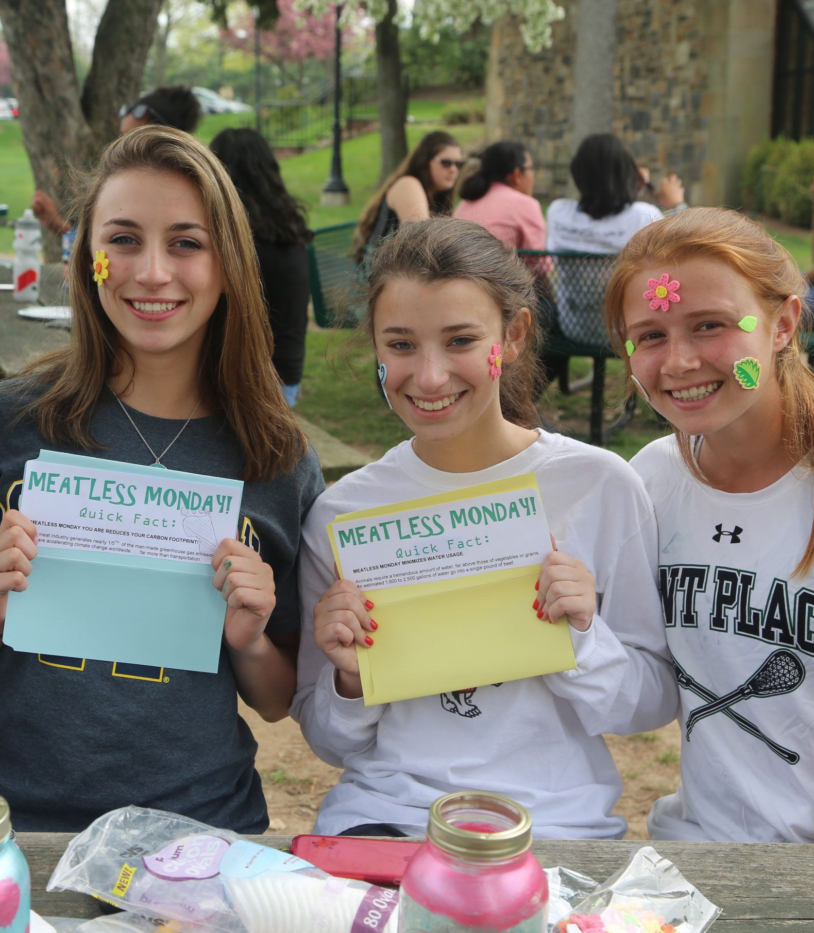 Students share Meatless Monday facts during the Eco Fair
