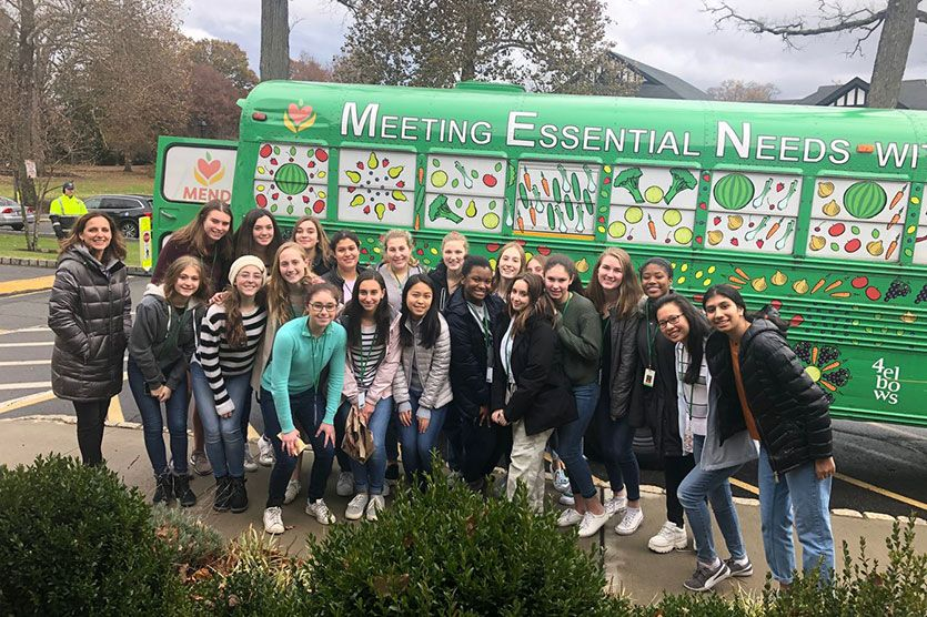 The Upper School Community Service Trip working with Meeting Essential Needs with Dignity (MEND)