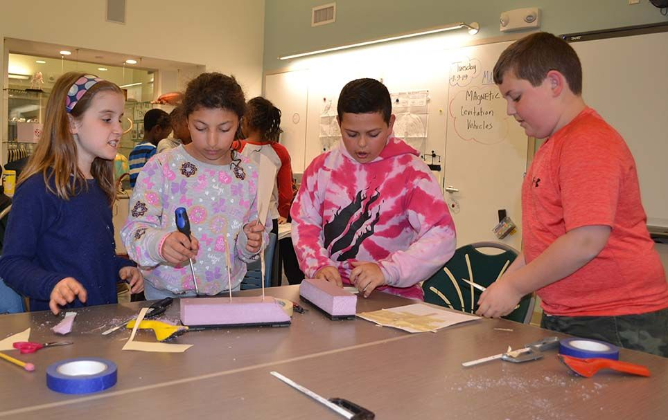 Fourth-graders created devices for a magnetic levitation project.