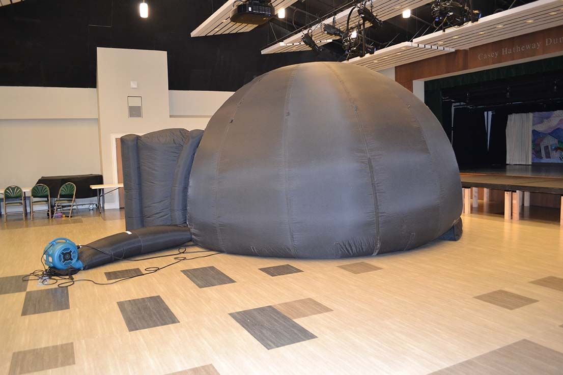 Fifth- and sixth-graders learned to analyze the night sky in the Museum of Science's traveling planetarium.