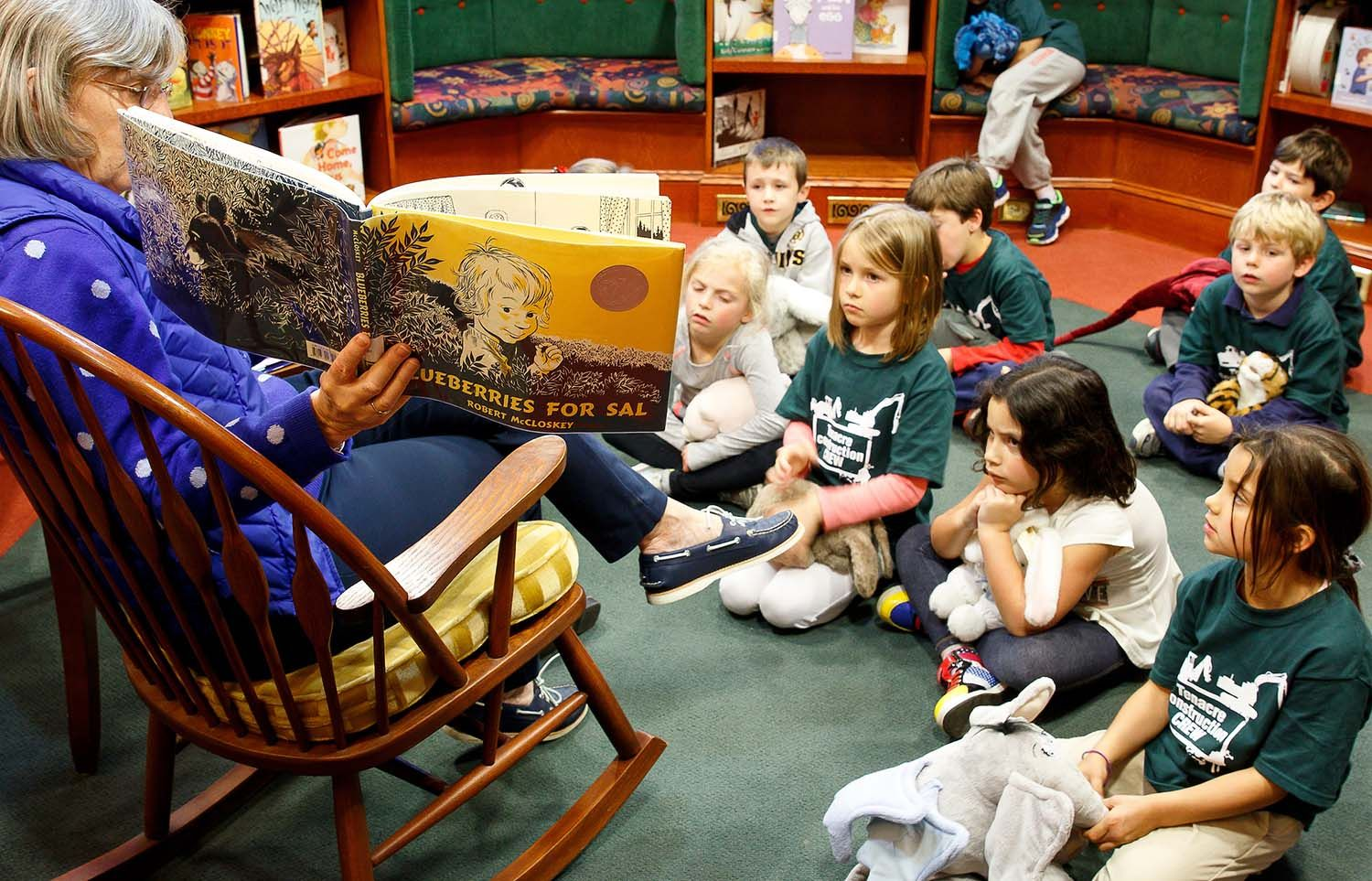 Mrs. Frazee, Tenacre's librarian, reads to kindergartners in the reading room