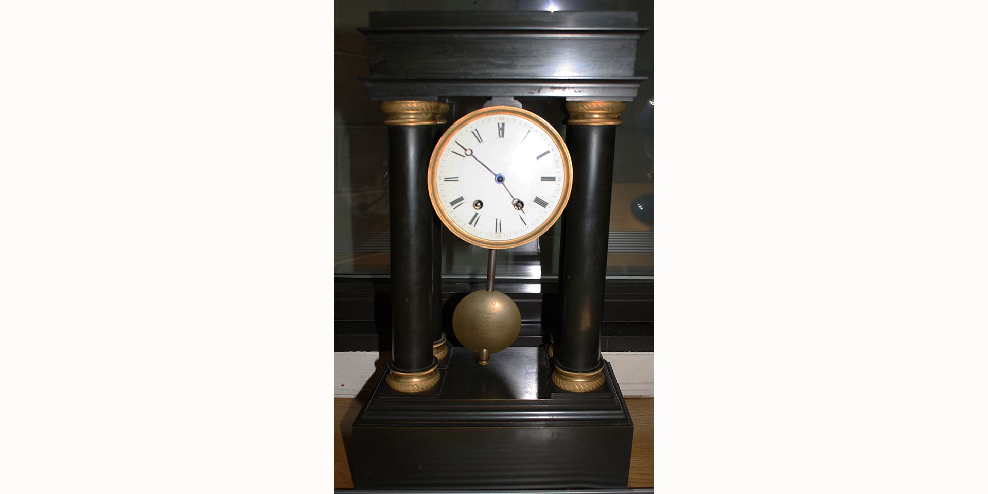 <center>This clock resides in Headmaster Johnson's office.  It was a wedding present from Old Boys to founding headmaster, John C. Jenkins.</center>