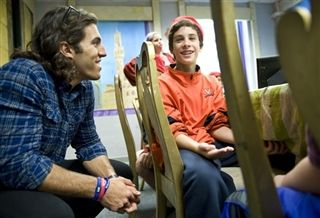 Lacrosse star Paul Rabil talks with Jay Budin, 11, while touring The Lab School, to see its hands-on, active teaching methods in Washington. Rabil and Pulitzer Prize-winning poet Philip Schultz have dyslexia and talked to kids at the school on how they were able to study for tests using non-traditional techniques. Photo by Linda Davidson/THE WASHINGTON POST