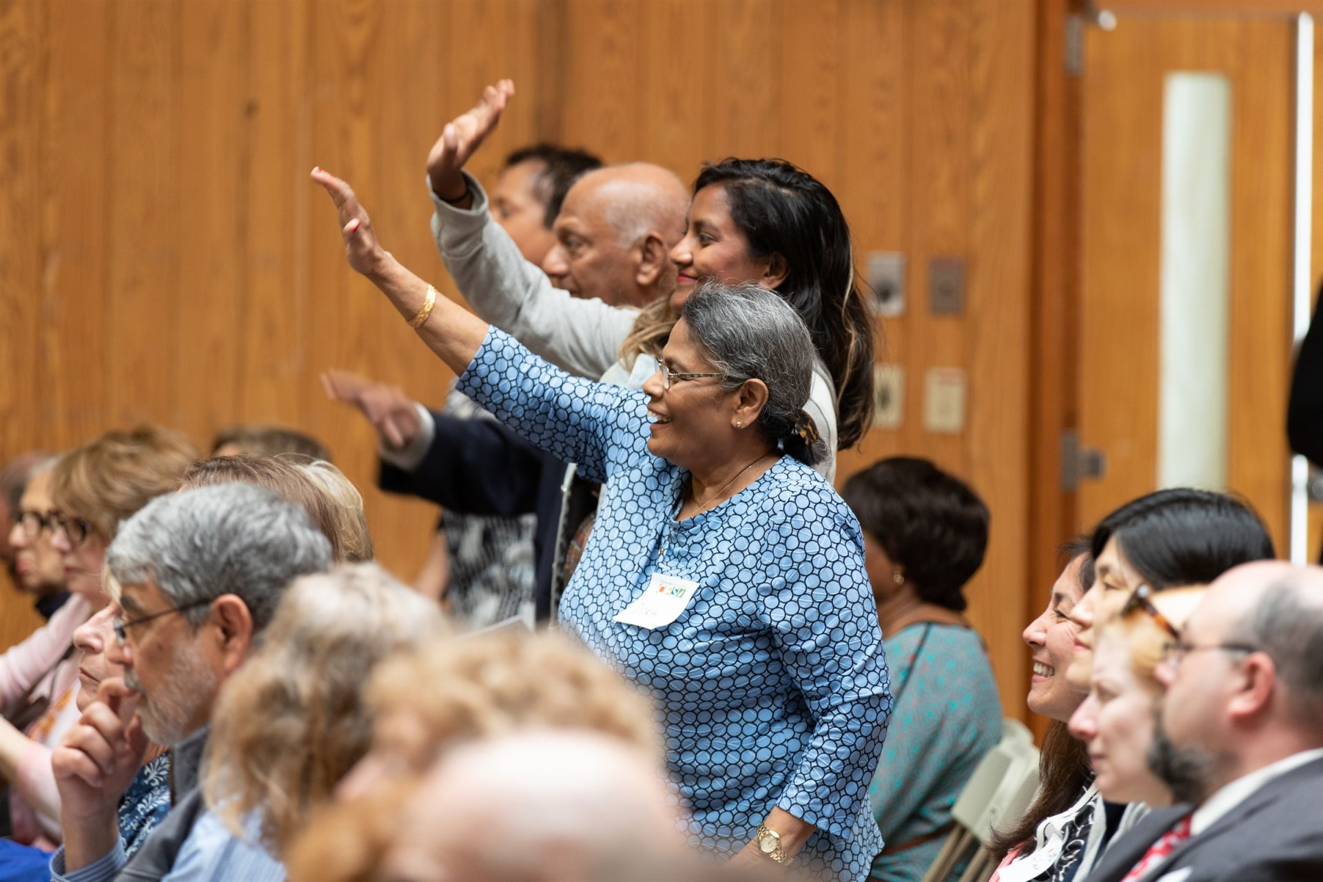 Family members wave to their student during the assembly for Significant Elders Day.