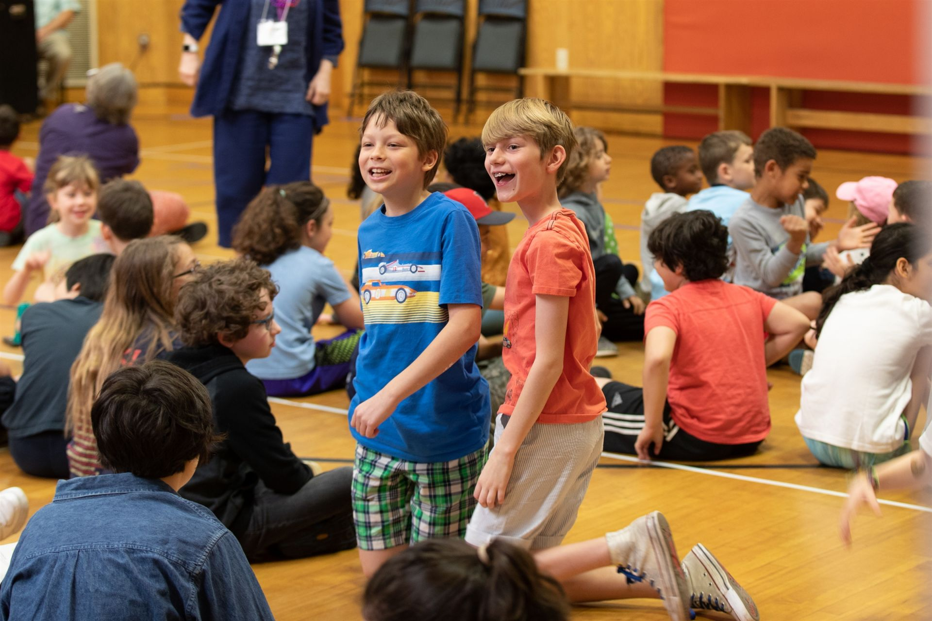 Students smile at their elders in the crowd before the Significant Elders Day assembly.
