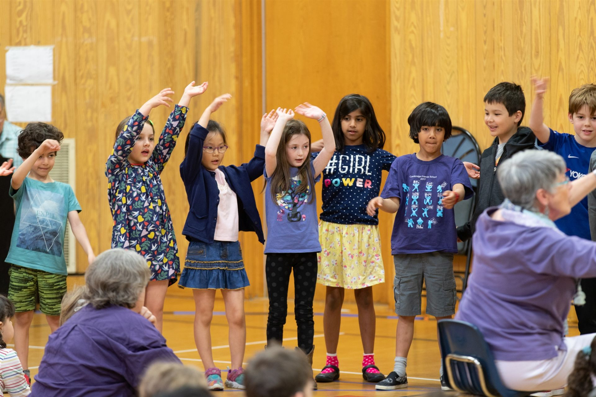 First-grade students perform a song about growing for the Significant Elders Day assembly.