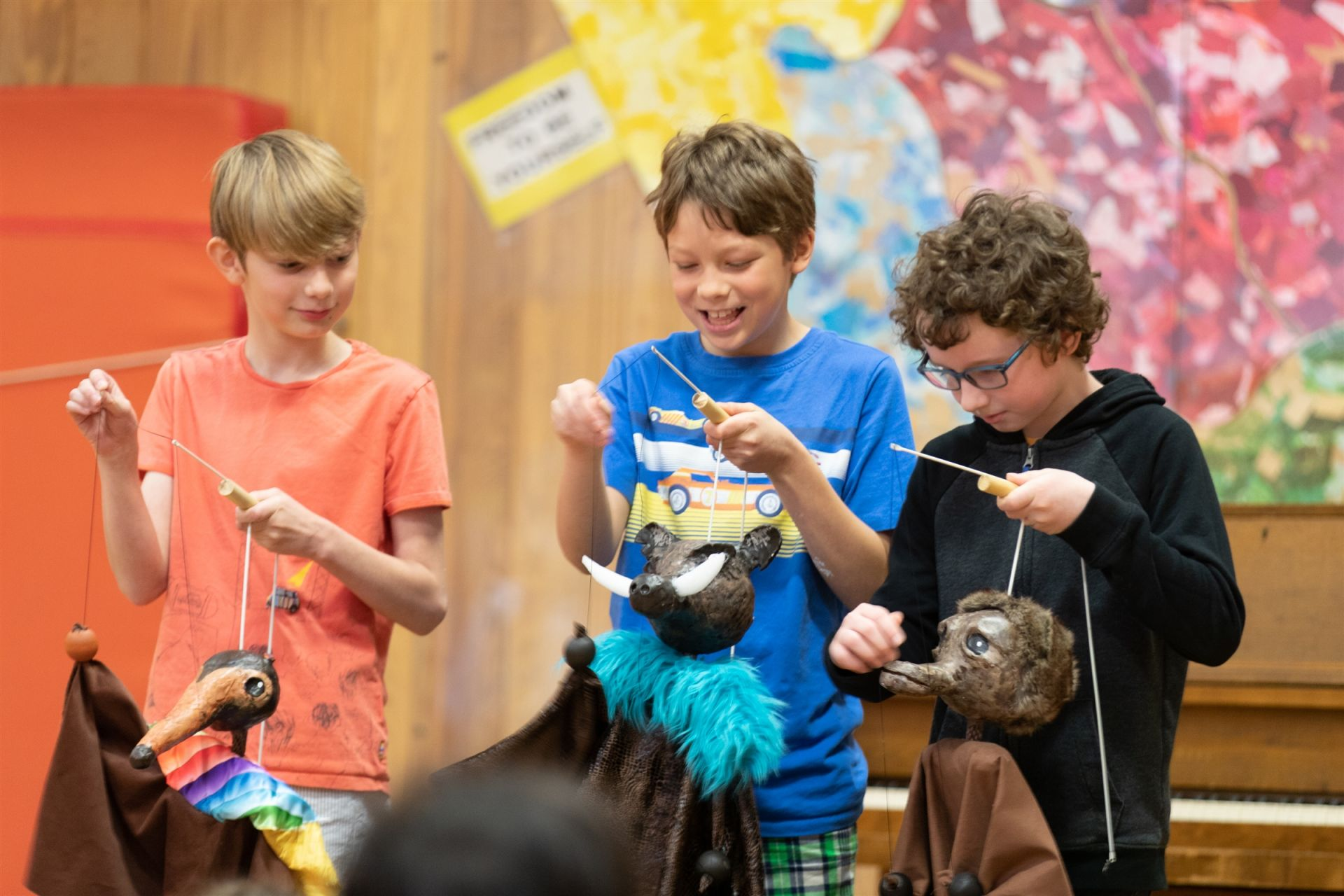 Three fifth-grade students perform a piece from their puppet show earlier in the year.