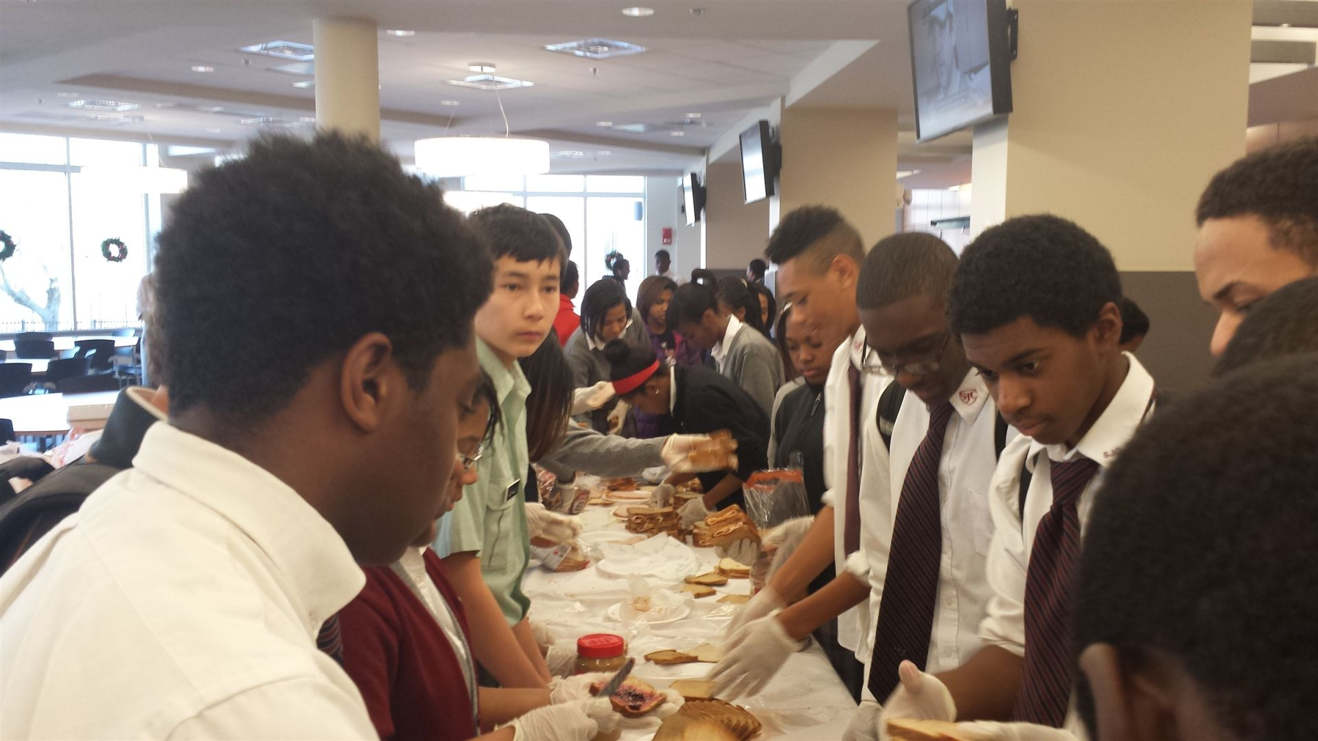 Track team making sandwiches for Martha's Table