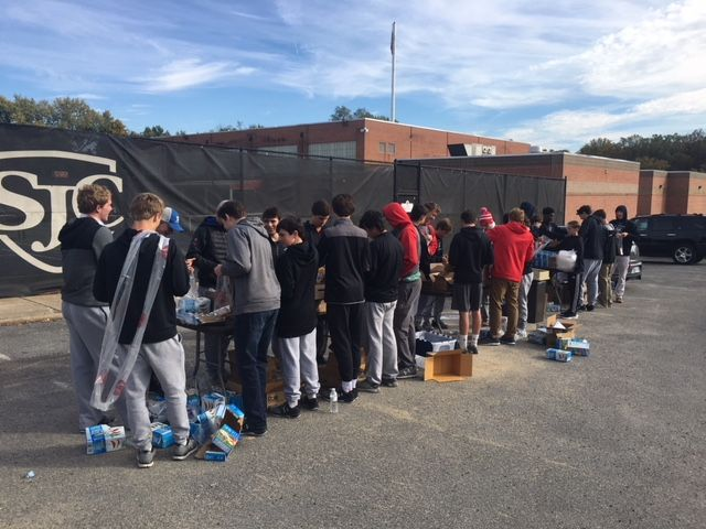 Boys Lacrosse making meals for Catholic Charities Cup of Joe